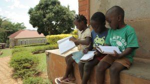 Children writing at Kampala Children's Centre